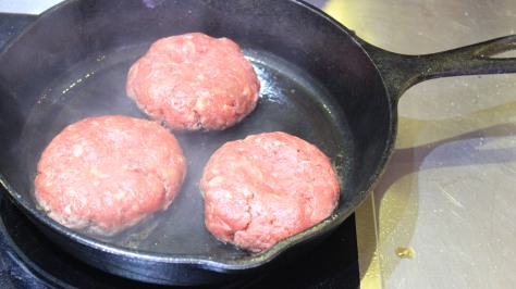 A smoking hot iron skillet is key to excellent burgers.
