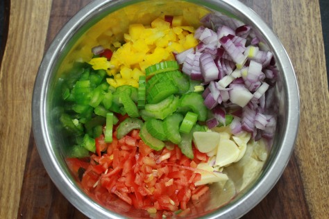 The Cajun Trinity consists of Onion, Celery, and Bell Pepper.