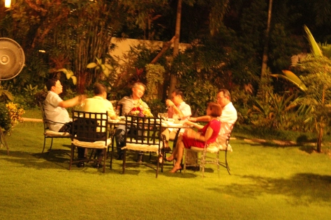 A table of guests on the lawn.