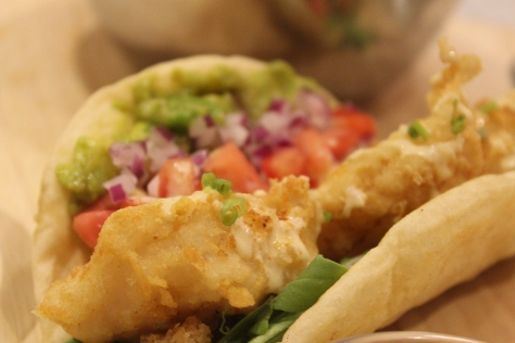 single fish taco bite side close up
