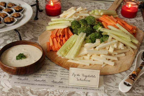 A vegetable platter consisting of jicama, brocoli, carrot, and cucumber spears.