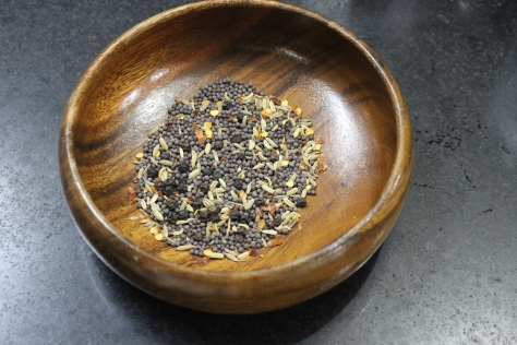 This is a blend of black mustard seed, fennel seed, crushed red pepper, and whole black peppercorns